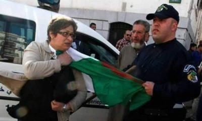 Policier drapeau manifestante démocratie Tebboune